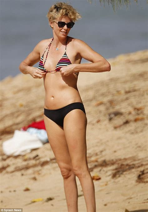 Charlize Theron shows off her enviable bikini body as she ...