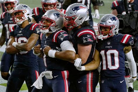 Cam Newton helps Patriots beat Ravens in rain and wind ...
