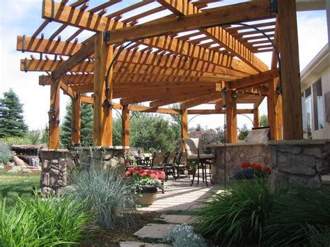 wooden shade structures wood pergola natural stone columns outdoor rooms