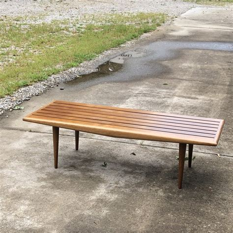 Using one of your foam brushes, stain all the wood pieces (we did 2 coats on the panel and only one coat on the legs). Mid-Century Modern Slatted Wood Coffee Table with Tapered Legs | Chairish