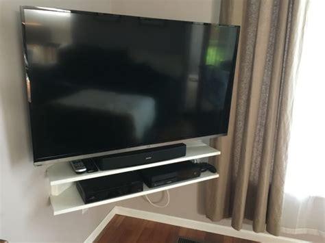 mounted tv  corner floating shelf verlo house  home