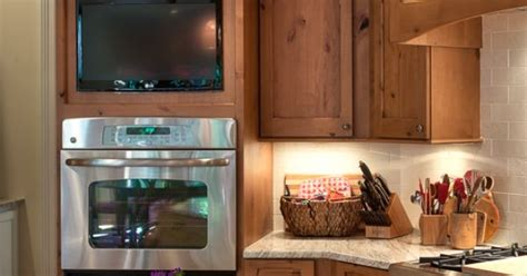 what is country kitchen custom knotty alder oven cabinet with tv summer vacation 7037