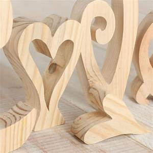 large unfinished chunky wood standing quotlovequot letters With large wooden letter cutouts