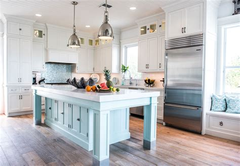 Coastal Style White Kitchen With Blue Island  Crystal
