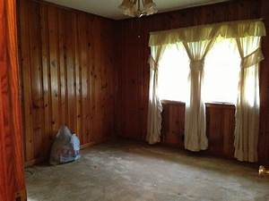 How to decorate around dark wood paneling?