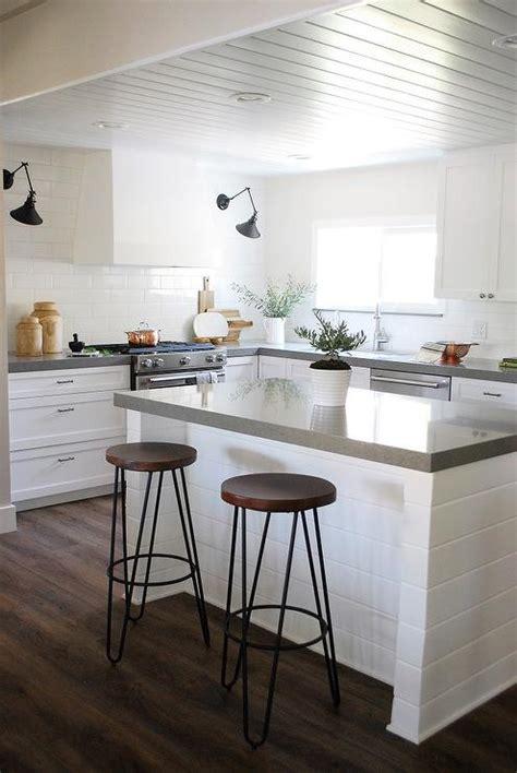 light grey shaker kitchen cabinets  white quartz