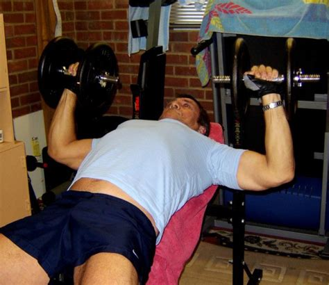 pec deck flyes with dumbbells chest exercises images frompo