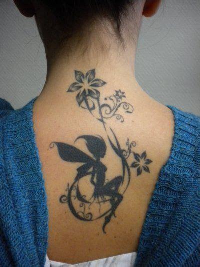 Tatouage Fée Noire Avec Fleurs Sur Le Dos  Tattoo Du Dos