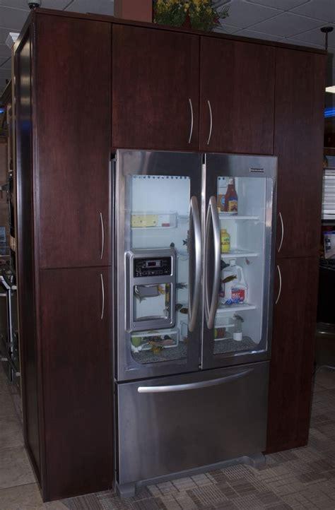 furniture style kitchen cabinets handmade custom refrigerator fish tank surround by