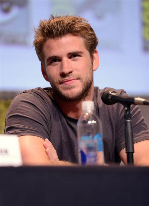 liam hemsworth triggered   thinks reporter calls