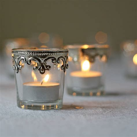 set of two silver and glass tea light holders by the