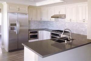 Antique White kitchen cabinet with grey quartz countertop ...