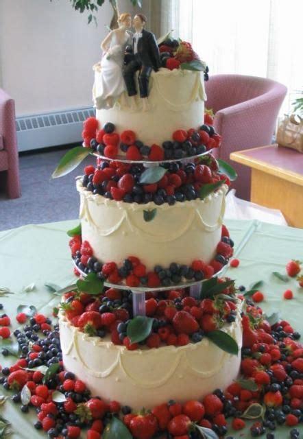 wedding cake  rasberries strawberries  blueberries
