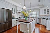 types of countertops types of kitchen countertops Kitchen Traditional with backsplash black counter coffered ...