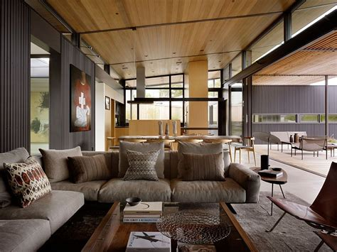 courtyard residence raw industrial elements tamed