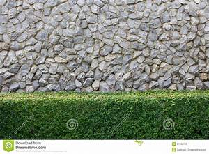 Stone wall and decorative garden royalty free stock images