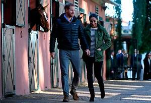 Prince Harry and Meghan Markle pet horses during final day ...