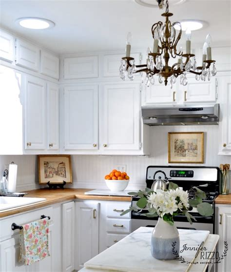white painted kitchen cabinets with brass hardware rizzo