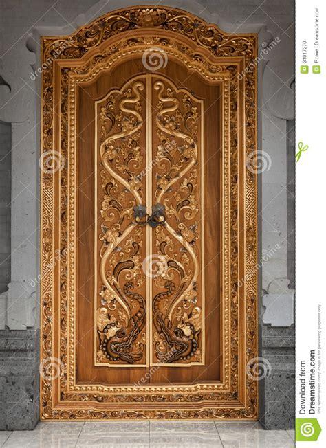 wooden door    temple  carvings indonesia