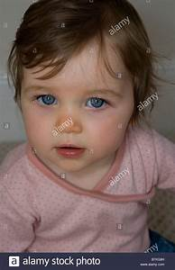 A baby girl with bright blue eyes Stock Photo, Royalty ...