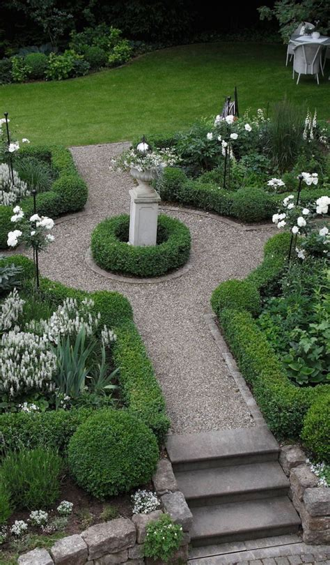 Formal Garden With Boxwood Plants And Urn  Boxwood Plant