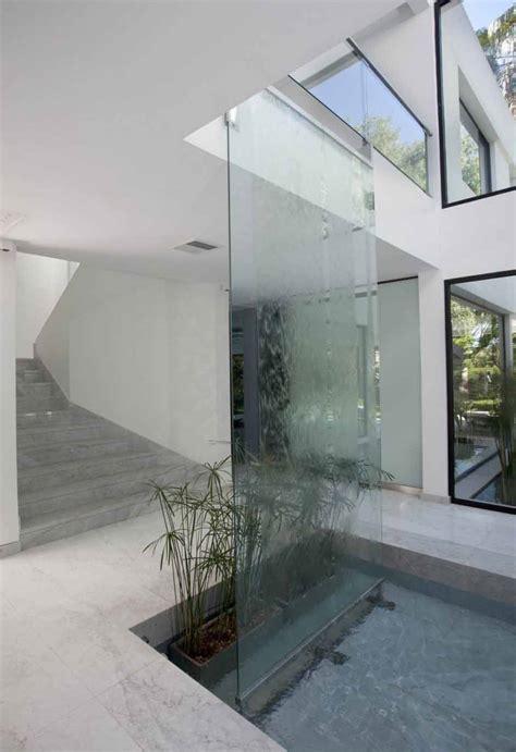 desain air terjun dinding  rumah minimalis modern