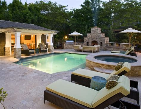 modern swimming pool with outdoor fireplace by bruce
