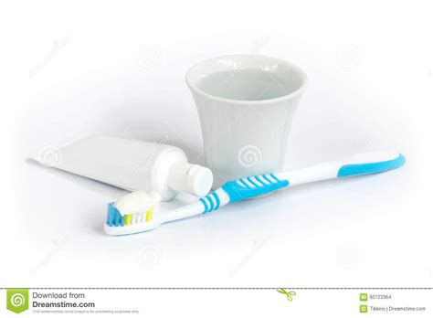 Toothbrush, Toothpaste And A Cup Of Water. Stock Photo
