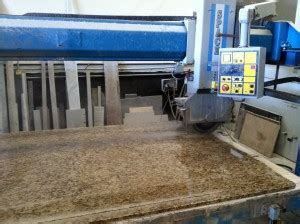 granite slab saw in our manufacturing facility stocker tile