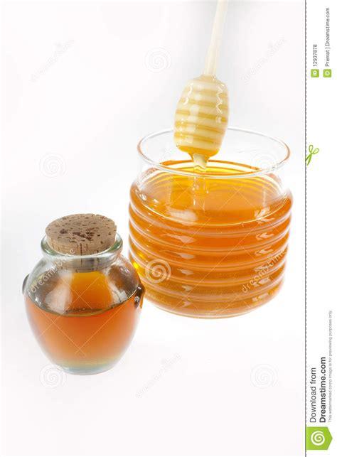 grand et petit pot de miel photos libres de droits image 12937878
