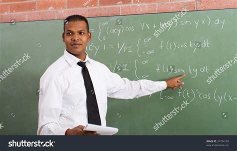 math teacher pointing blackboard 31704178