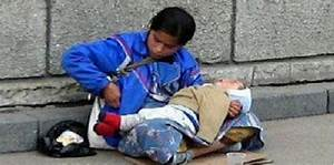 Why dose the child in hands of the beggar always sleeping?