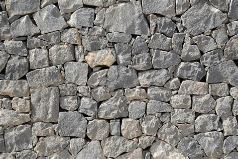 rock wall design this shows actual texture in the nature by seeing the roughness of the rocks texture texture