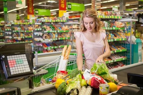 Young woman buying food at the grocery ⬇ Stock Photo ...