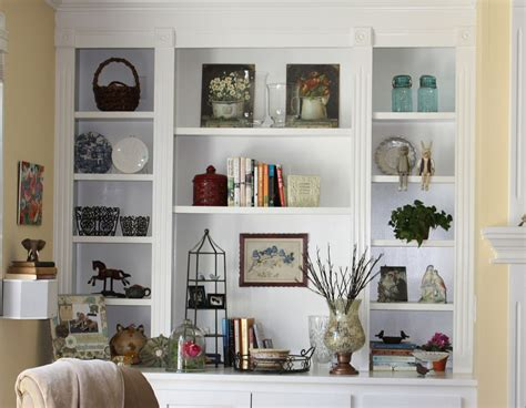 corner display with glass doors white wall shelves for effective storage in small kitchen
