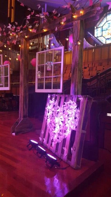 rooted womens conference arbor  windows stage decor