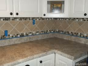 how to do backsplash tile in kitchen kitchen diy remodel on a budget 2 boys 1 one