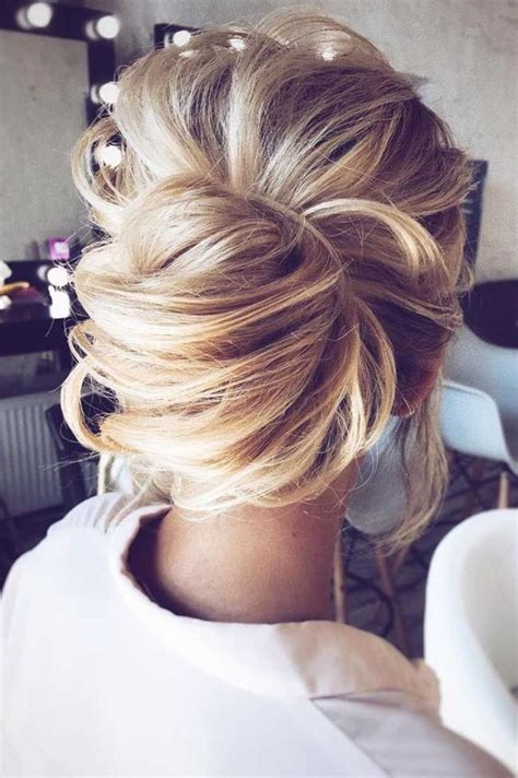 modern day chignon style  messy bun updo beautiful