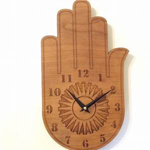 Buddha s hand wall clock wood