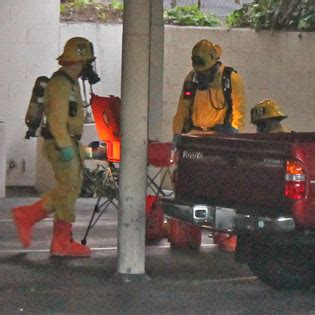 hazmat crews gather   carport  examine  contents