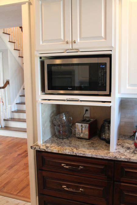 cabinet depth microwave oven micro appliance garage hides the microwave and small