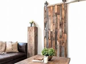 Porte Coulissante En Bois : une porte coulissante en planches de bois us es elle ~ Melissatoandfro.com Idées de Décoration