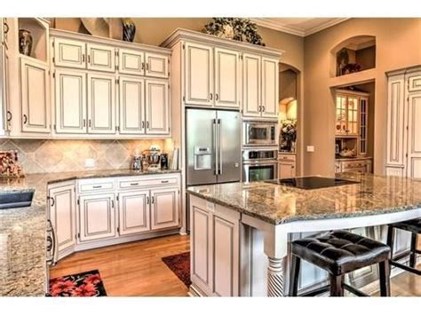 white kitchen cabinets and granite countertops look