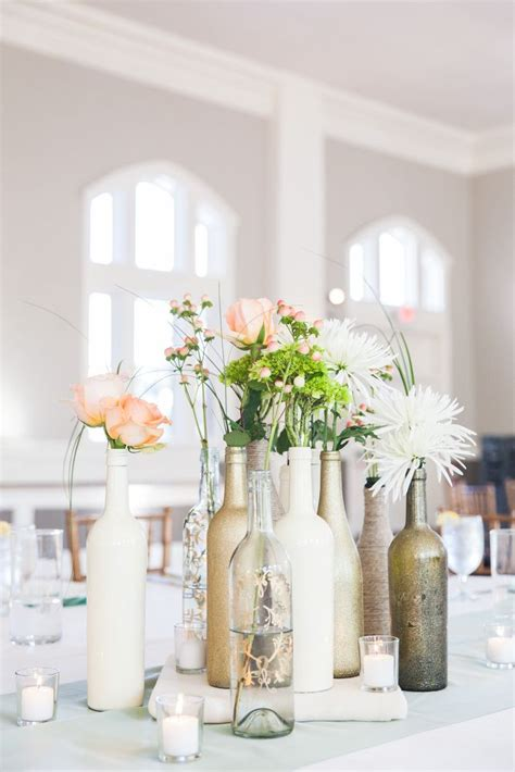 wine bottle centerpieces painted in gold or white with an