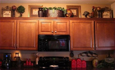 how to decorate the top of your kitchen cabinets how do you decorate above your kitchen cabinets