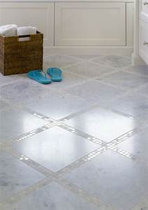 Bathroom floor with marble tiles and marble mosaic inset for How to clean marble tiles in bathroom