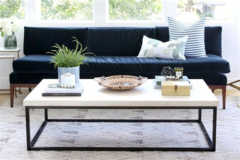 Learn the tips and tricks we use to style a round coffee table! Coffee Table Styling Shopping Guide