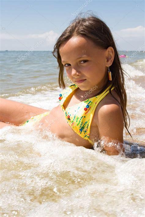 girl  water splashes   sea stock photo