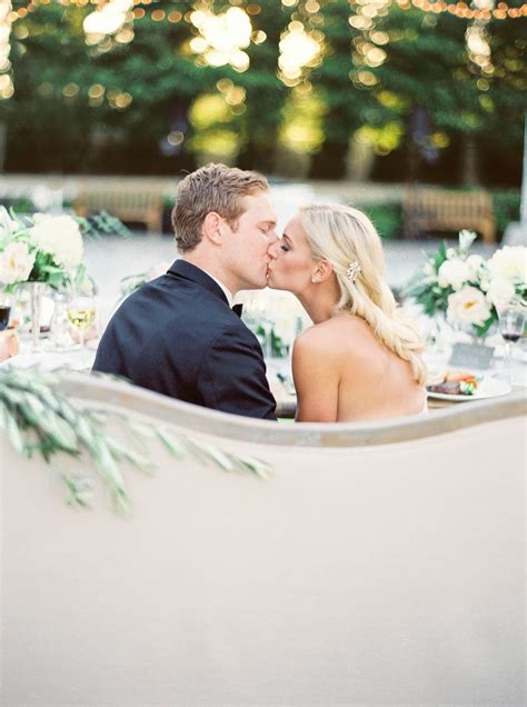 bride  groom wedding reception kiss