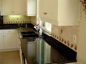 Galaxy Black granite counter top with white cabinets ...
